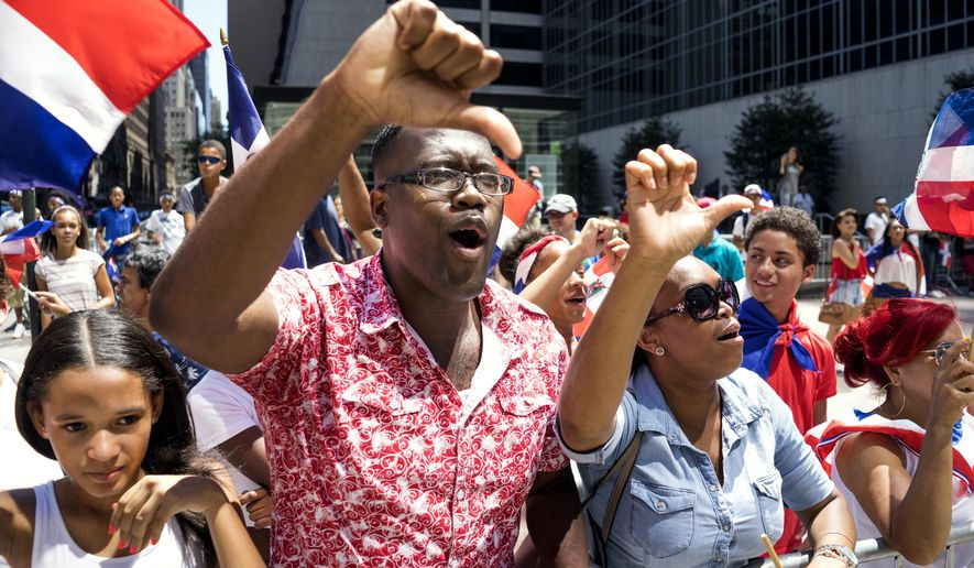 Attendees show a thumbs down and boo as New York City Mayor Bill de Blasio passes by during the Dominican Day Parade Sunday, Aug. 9, 2015, in New York. This year's Grand Marshall is Baseball Hall of Fame inductee Pedro Martinez. (AP Photo/Craig Ruttle) the photo