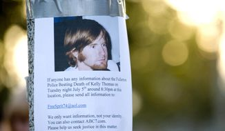 FILE - This July 12, 2011 file photo shows one of the posters of Kelly Thomas posted around the Fullerton Transportation Center in the hopes of eliciting information of a police beating they believe led to the death of Thomas in Fullerton, Calif. Two Southern California policemen who were tried and ultimately acquitted in the beating death of Thomas in 2011 violated department policy on use of force and officer conduct, according to a previously confidential internal report. The report, prepared by an independent investigator, has come to light four years after Thomas' death as part of the evidence to be introduced at a civil wrongful death trial against the Fullerton Police Department. (Joshua Sudock/Orange County Register via AP, File)   MAGS OUT; LOS ANGELES TIMES OUT