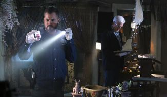 "In this image released by CBS, George Eads, left, and Ted Danson appear in a scene from ""CSI: Crime Scene Investigation."" ""CSI,"" which debuted in 2000, will wrap with a two-hour finale on Sept. 27. Original cast members including William Petersen and Marg Helgenberger are returning for the send-off. (Michael Yarish/CBS  via AP)"