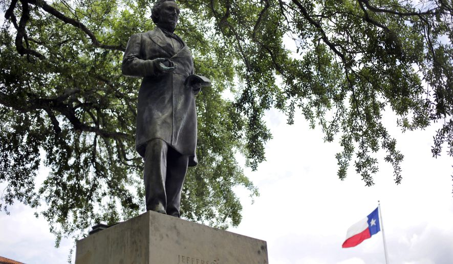 FILE - In this May 5, 2015 file photo, a statue of Jefferson Davis is seen on the University of Texas campus in Austin, Texas. A University of Texas task force recommended Monday, Aug. 10, 2015, moving the Jefferson Davis statue to elsewhere on campus, or at least adding an explanatory plaque with historical context on why the president of the Confederacy was being honored with a bronze likeness.  (AP Photo/Eric Gay, file)