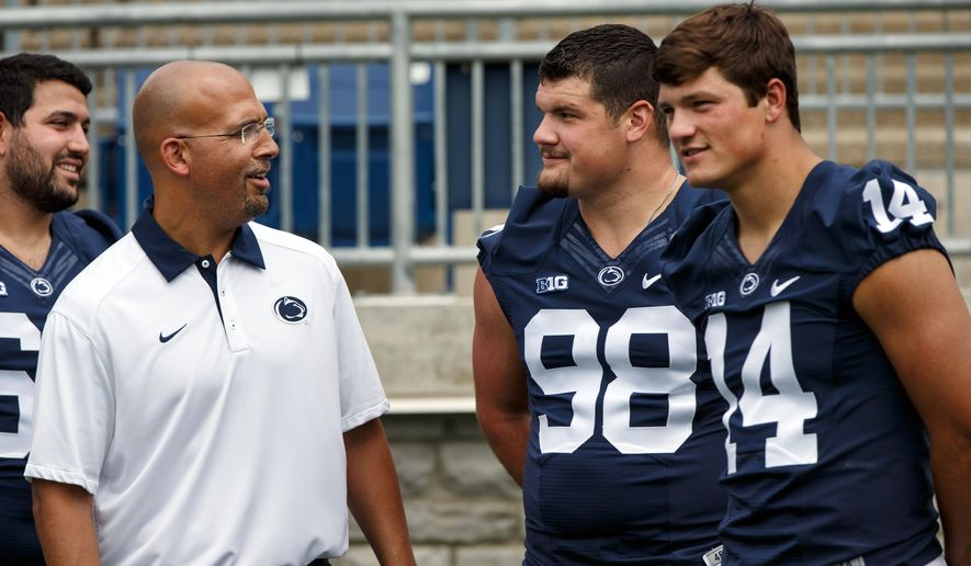 Penn State head coach James Franklin talks with captains defensive tackle Anthony Zettel and quarterback Christian Hackenberg during photo day at Beaver Stadium Sunday, Aug. 9, 2015. (Joe Hermitt/PennLive.com via AP)