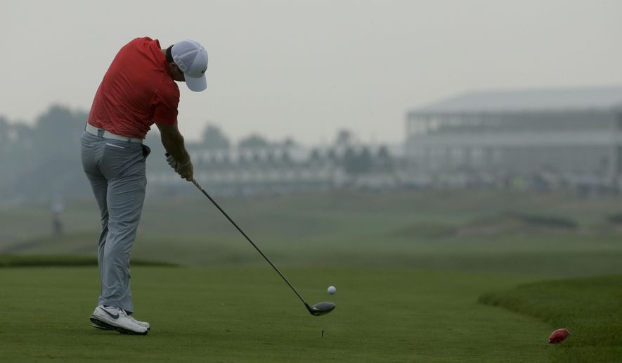 Rory McIlroy, of Northern Ireland, hits a tee shot on the 16th hole during a practice round for the PGA Championship golf tournament at Whistling Straits Golf Course on Monday, Aug. 10, 2015 in Haven, Wis. (AP Photo/Chris Carlson)