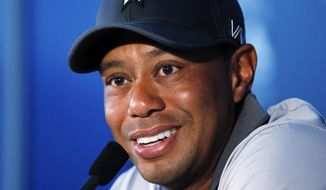 Tiger Woods talks in the media room after a practice round for the PGA Championship golf tournament Tuesday, Aug. 11, 2015, at Whistling Straits in Haven, Wis. (AP Photo/Julio Cortez)
