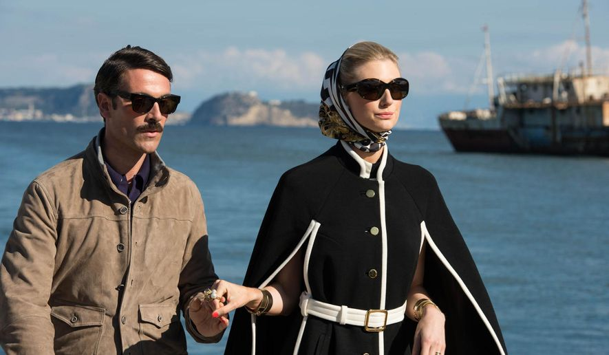 """This photo provided by Warner Bros. Pictures shows, Luca Calvani, left, as Alexander and Elizabeth Debicki, right, as Victoria in Warner Bros. Pictures' action adventure """"The Man from U.N.C.L.E.,"""" a Warner Bros. Pictures release. The movie opens Aug. 14, 2015. (Daniel Smith/Warner Bros. Pictures via AP)"""
