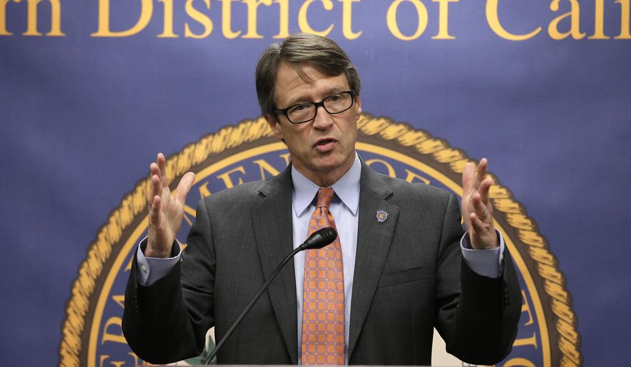 Benjamin B. Wagner, United States Attorney for the Eastern District of California, discusses the investigation into a scheme where as many as 100 commercial truck drivers paid up to $5,000 to  California Department of Motor Vehicle employees for illegal California licenses, Tuesday, Aug. 11, 2015, in Sacramento,Calif.  Court records say that three DMV employees, two in Salinas and one in Sacramento, changed computer records to falsely show that drivers passed written and behind-the-wheel tests. The owners of three truck driving schools have also been charged with conspiracy to commit bribery and to commit identity fraud.  (AP Photo/Rich Pedroncelli)