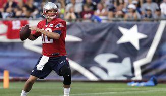 New England Patriots quarterback Tom Brady sets to pass during NFL football training camp in Foxborough, Mass., Wednesday, Aug. 5, 2015. (AP Photo/Charles Krupa)