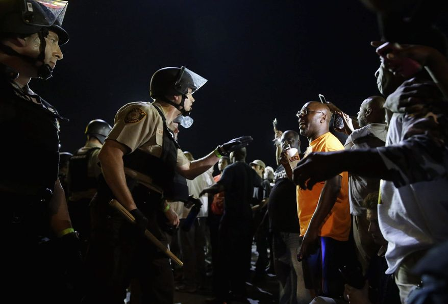 Ferguson, Missouri, was a community on edge again Monday, a day after a protest marking the anniversary of Michael Brown's death was punctuated with gunshots. (Associated Press)