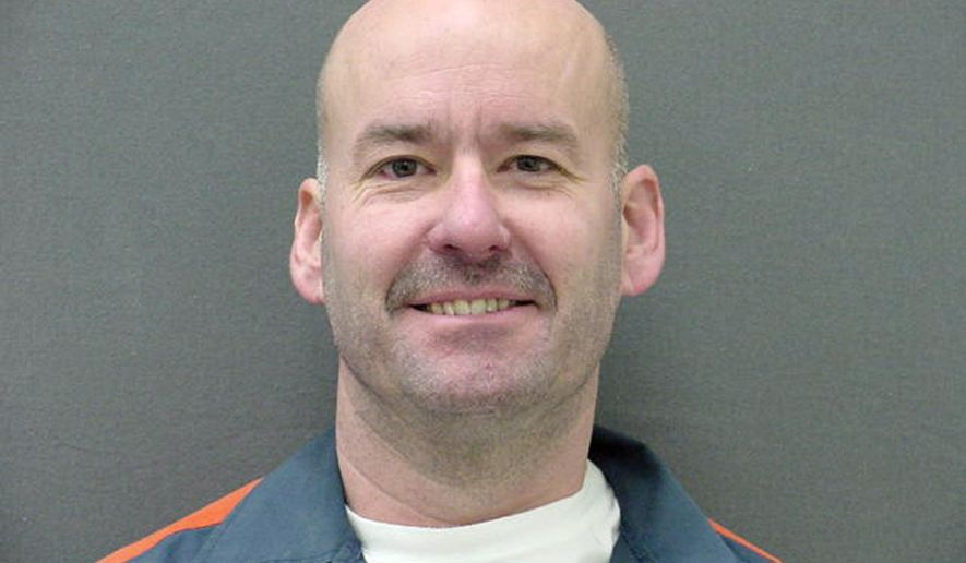 This undated booking photo proved by the Michigan Department of Corrections shows Kevin King. A jury last week awarded $1,251 to the convicted killer who filed a lawsuit after he was barred from touching his wife during a Michigan prison visit. King claimed a guard was retaliating against him for past complaints when she prohibited him from embracing his wife during a 2012 visit at the Cotton prison in Jackson, Mich. King, 52, is serving a life sentence for murder committed during an armed robbery in Oakland County in 1982. (Michigan Department of Corrections via AP)