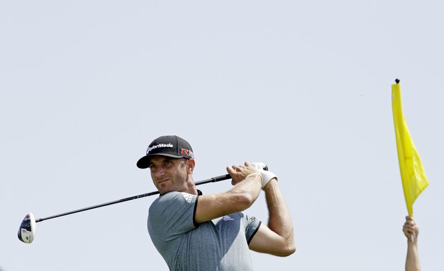 Dustin Johnson hits on the 11th hole during a practice round for the PGA Championship golf tournament Tuesday, Aug. 11, 2015, at Whistling Straits in Haven, Wis. (AP Photo/Brynn Anderson)