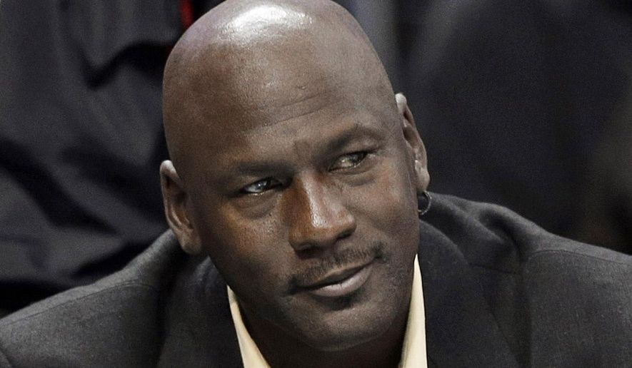 Charlotte Bobcats owner Michael Jordan watches an NBA basketball game between the Bobcats and the Chicago Bulls in Charlotte, N.C., April 16, 2014. (AP Photo/Chuck Burton, File) ** FILE **