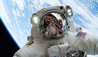 Astronaut Mike Hopkins takes a selfie while on a December 24, 2013 spacewalk. Image from Wikimedia commons.