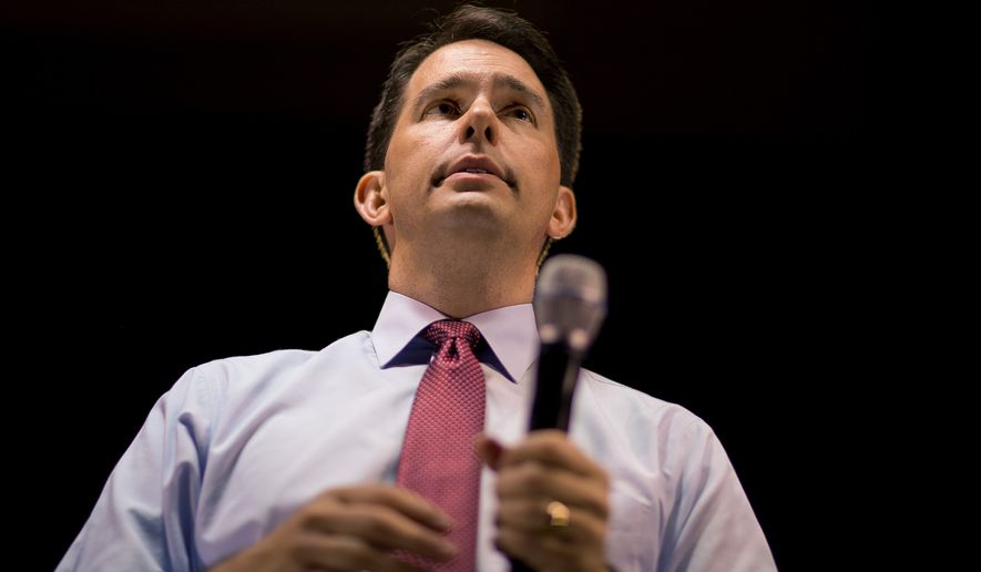 "In justifying the subsidy to the Milwaukee Bucks, Wisconsin Gov. Scott Walker said last month that it would be ""cheaper to keep them"" and that the state would get $3 back for every dollar it invests in the team. (Associated Press)"