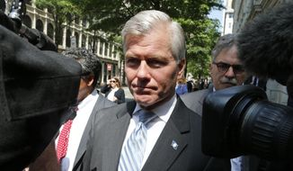Former Virginia Gov. Bob McDonnell navigates a group of cameras as he leaves the 4th U.S. Circuit Court of Appeals after a hearing the appeal of his corruption conviction in Richmond, Va., in this Tuesday, May 12, 2015, file photo. (AP Photo/Steve Helber)
