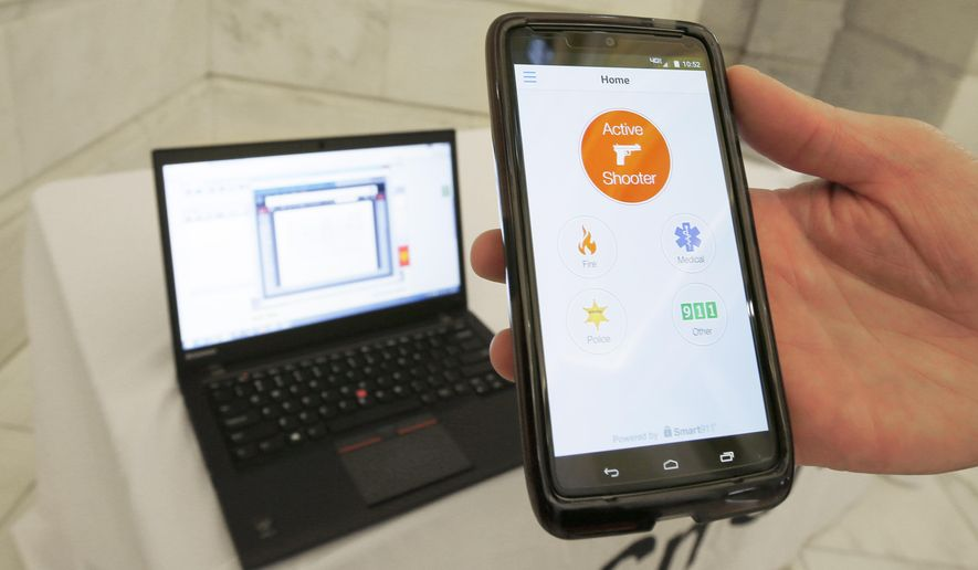 A smartphone is held during a demonstration of the Rave Panic Button application at the Arkansas state Capitol in Little Rock, Ark., Tuesday, Aug. 11, 2015. The system is designed to enable authorities to respond to crises faster across more than 1,000 public schools in Arkansas. (AP Photo/Danny Johnston)