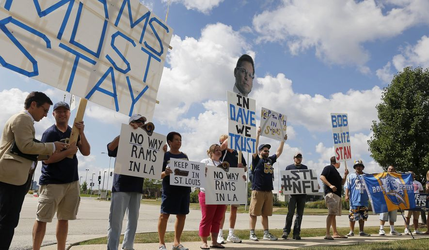 St. Louis Rams fans protest outside the NFL Owners Meeting at Hyatt Regency hotel, Tuesday, Aug. 11, 2015, in Schaumburg, Ill. (AP Photo/Christian K. Lee)