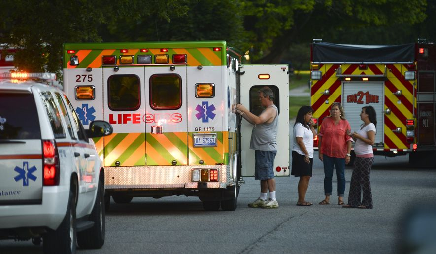 A woman was taken to the hospital with minor injuries after a deck collapsed in Grand Rapids Township, Mich., on Tuesday, Aug. 11, 2015. Authorities say the woman was injured when the second-story deck collapsed during her 80th birthday celebration. (Alex McDougall/The Grand Rapids Press via AP) ALL LOCAL TELEVISION OUT; LOCAL TELEVISION INTERNET OUT; MANDATORY CREDIT