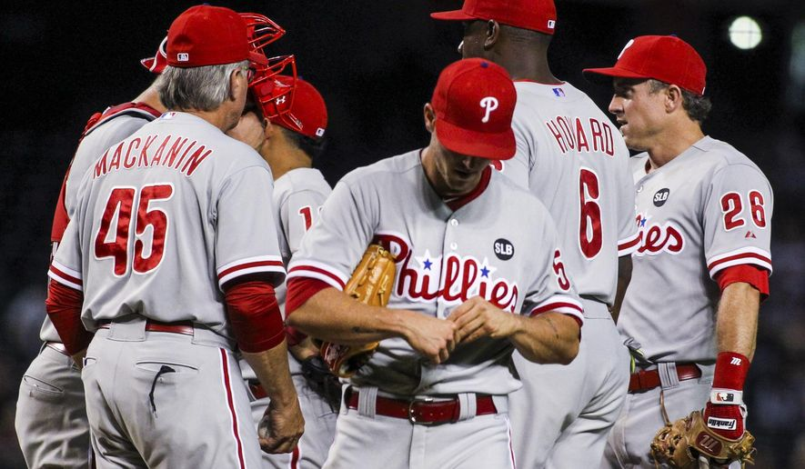 Philadelphia Phillies starting pitcher David Buchanan (55) is removed from the baseball game against the Arizona Diamondbacks during the second inning Tuesday, Aug. 11, 2015, in Phoenix. (Isaac Hale/The Arizona Republic via AP)