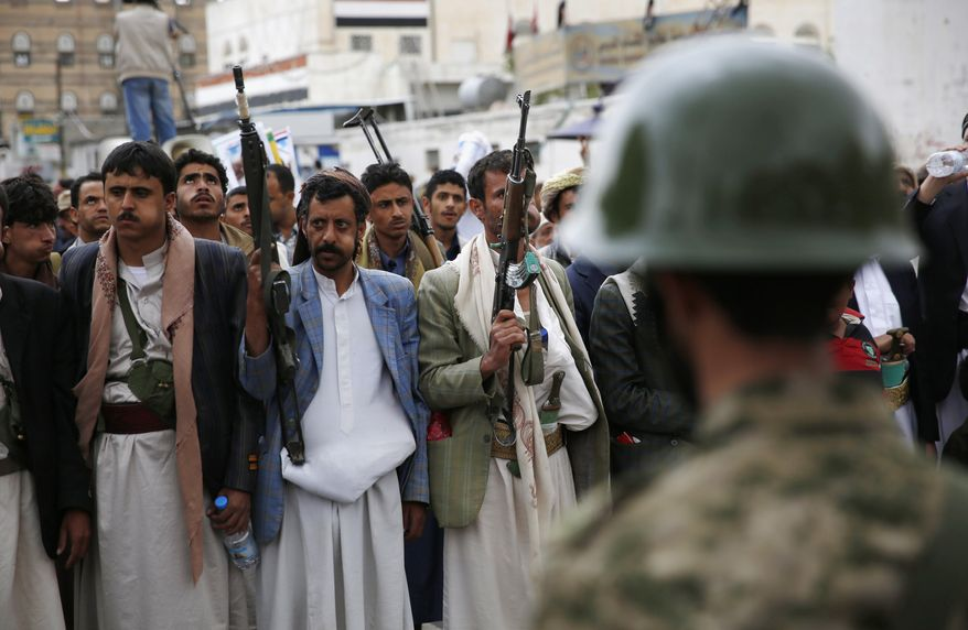 Shiite rebels known as Houthis holds their weapons during a rally against Saudi-led airstrikes in Sanaa, Yemen, on Aug. 11, 2015. (Associated Press) **FILE**