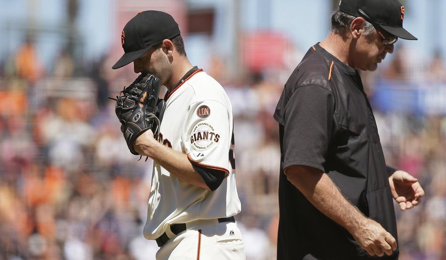 San Francisco Giants starting pitcher Chris Heston, left, walks to the dugout after being removed by manager Bruce Bochy, right, during the seventh inning of a baseball game against the Houston Astros on Wednesday, Aug. 12, 2015, in San Francisco. (AP Photo/Eric Risberg)