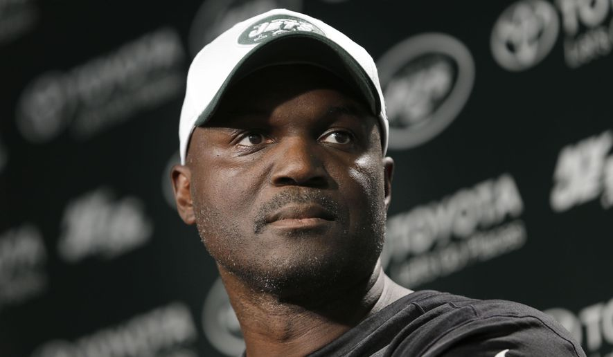 New York Jets coach Todd Bowles speaks to reporters after NFL football practice in Florham Park, N.J., Tuesday, Aug. 11, 2015. Quarterback Geno Smith will be sidelined at least 6-10 weeks with a broken jaw after being punched by teammate Ikemefuna Enemkpali in the locker room Tuesday morning. Smith, entering his third season, required surgery to repair the injuries. (AP Photo/Seth Wenig)