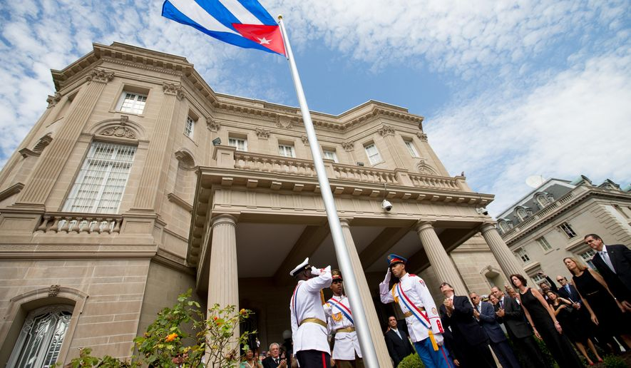 In this July 20, 2015, file photo, Cuban Foreign Minister Bruno Rodriguez, right of center, applauds with other dignitaries after raising the Cuban flag over their new embassy in Washington. The Obama administration doesn't plan to invite Cuban dissidents to Secretary of State John Kerry's historic flag-raising at the U.S. Embassy in Havana on Friday, Aug. 14, vividly illustrating how U.S. policy is shifting focus from the island's opposition to its single-party government. (AP Photo/Andrew Harnik, Pool, File)