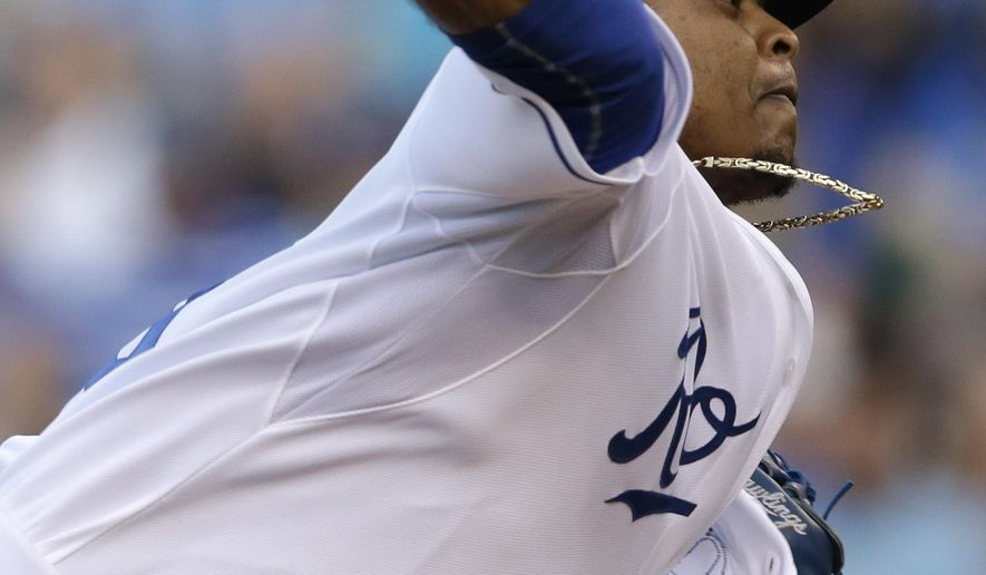 Kansas City Royals starting pitcher Edinson Volquez delivers to a Detroit Tigers batter during the first inning a baseball game at Kauffman Stadium in Kansas City, Mo., Wednesday, Aug. 12, 2015. (AP Photo/Orlin Wagner)