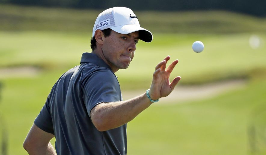 Rory McIlroy, of Northern Ireland, catches a ball on the range before a practice round for the PGA Championship golf tournament Wednesday, Aug. 12, 2015, at Whistling Straits in Haven, Wis. (AP Photo/Chris Carlson)