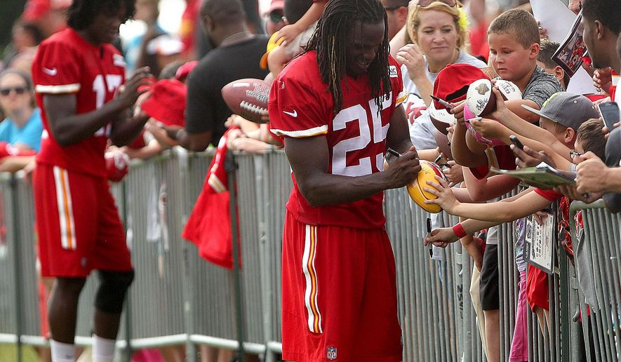 Kansas City Chiefs running back Jamaal Charles signs autographs after practice Monday, Aug. 10, 2015 in St. Joseph, Mo. (Jessica Stewart/The St. Joseph News-Press via AP)