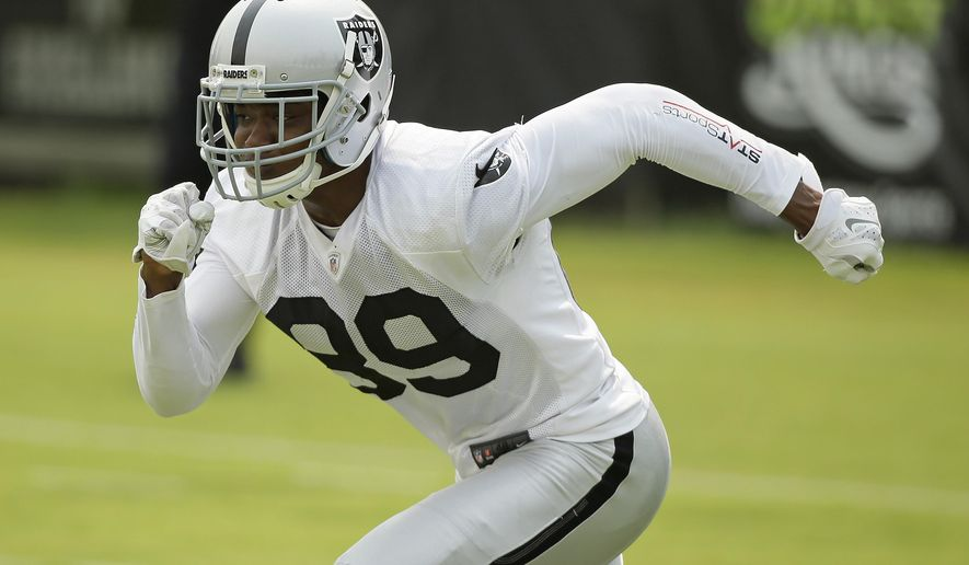 FILE - In this July 31, 2015, file photo, Oakland Raiders wide receiver Amari Cooper goes out for a pass during their football training camp in Napa, Calif. Raiders quarterback Derek Carr is excited to show off his shiny new toy when rookie receiver Amari Cooper makes his exhibition debut Friday, Aug. 14. (AP Photo/Eric Risberg, File)
