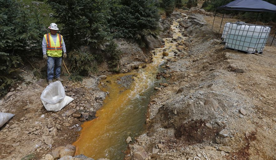 An Environmental Protection Agency contractor works on the cleanup in the aftermath of the blowout at the Gold King mine, which triggered a major spill of toxic wastewater, outside Silverton, Colorado. (Associated Press)