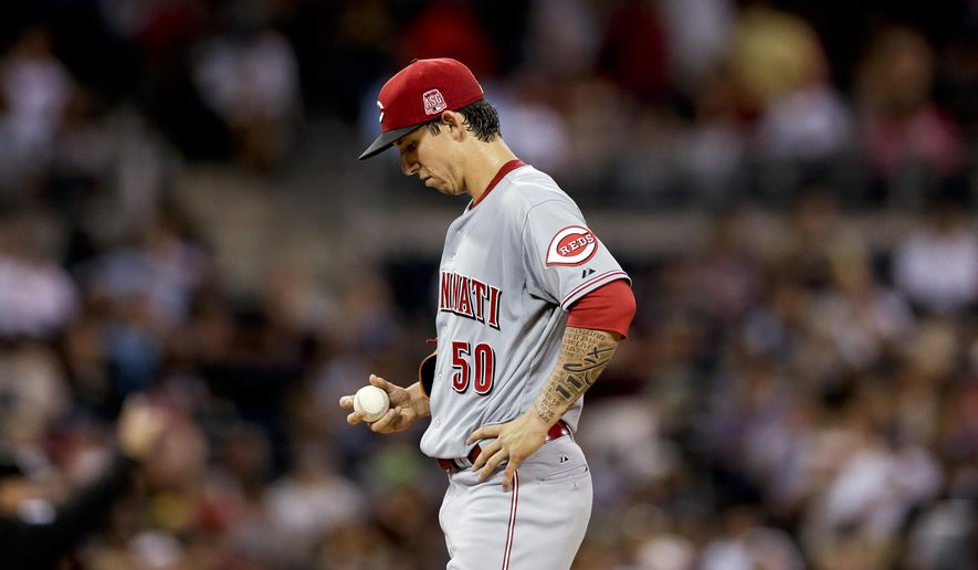 Cincinnati Reds starting pitcher Michael Lorenzen looks at the ball shortly before leaving the baseball game against the San Diego Padres during the second inning Tuesday, Aug. 11, 2015, in San Diego. (AP Photo/Gregory Bull)