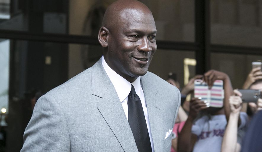 Michael Jordan leaves the U.S. courthouse Tuesday, Aug. 11, 2015, in Chicago. after the first day of his civil trial against the defunct grocery-store chain Dominick's Finer Foods for using his name and jersey number without permission. (Ashlee Rezin/Sun-Times Media via AP)
