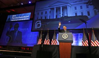 """President Barack Obama speaks at the 2013 Planned Parenthood National Conference in Washington on Friday, April 26, 2013. Obama, who supports abortion rights, became the first sitting president to make an in-person address to Planned Parenthood, vowing to help fight against state abortion restrictions that he said are designed to """"turn back the clock to policies more suited to the 1950s than the 21st century."""" (AP Photo/Charles Dharapak/File)"""