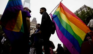 Protestors demonstrate calling on Pennsylvania to add sexual orientation to its hate crime law at John F. Kennedy Plaza, also known as Love Park, Thursday, Sept. 25, 2014, in Philadelphia. The renewed call for the legislation comes in response to the Sept. 11 beating of a gay couple. (AP Photo/Matt Rourke)