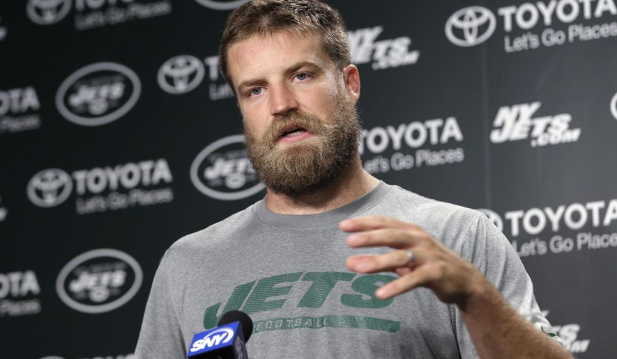 New York Jets quarterback Ryan Fitzpatrick speaks to reporters after NFL football practice in Florham Park, N.J., Tuesday, Aug. 11, 2015. Quarterback Geno Smith will be sidelined at least 6-10 weeks with a broken jaw after being punched by teammate Ikemefuna Enemkpali in the locker room Tuesday morning. Smith, entering his third season, required surgery to repair the injuries. (AP Photo/Seth Wenig)