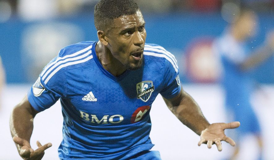 Montreal Impact's Anthony Jackson-Hamel celebrates after scoring against the Vancouver Whitecaps during the second half in the first leg of the Canadian Championship soccer final, in Montreal on Wednesday, Aug. 12, 2015. (Graham Hughes/The Canadian Press via AP)
