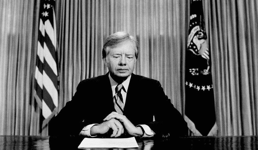 FILE - In this April 25, 1980 file photo, President Jimmy Carter prepares to make a national television address from the Oval Office at the White House in Washington, on the failed mission to rescue the Iran hostages. On Wednesday, Aug. 12, 2015, Carter announced he has cancer and will undergo treatment at an Atlanta hospital. (AP Photo)