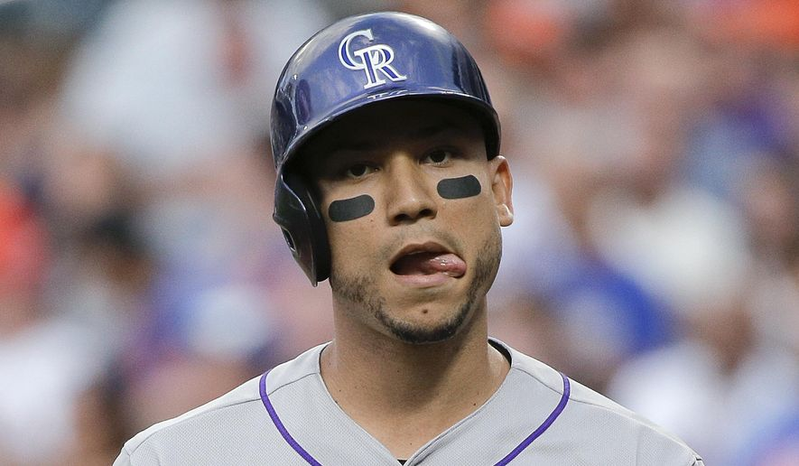 Colorado Rockies' Carlos Gonzalez reacts after striking out swinging against the New York Mets during the first inning of a baseball game, Wednesday, Aug. 12, 2015, in New York. (AP Photo/Julie Jacobson)