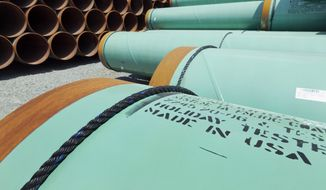 Coated steel pipe manufactured for Keystone XL may be brought out of storage if the next president supports the project. (Associated Press/File)