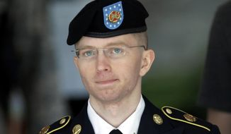 In this June 5, 2013, file photo Army Pvt. Chelsea Manning, then-Army Pfc. Bradley Manning, is escorted out of a courthouse in Fort Meade, Md., after the third day of her court martial. (AP Photo/Patrick Semansky, File)