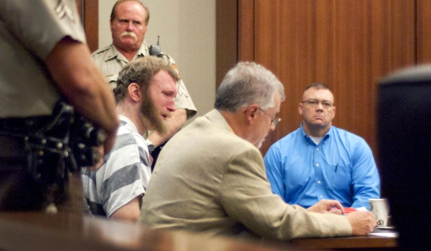 Thomas J. Lee, left, weeps in Troup County Superior Court, Wednesday, Aug. 12, 2015, in LaGrange, Ga., after pleading guilty but mentally ill in killing five people in January. Lee, 26, will spend the rest of his life in prison without the possibility of parole for the deaths of his wife, Christie Lee, her daughter, Bailey Burtron, Lee's parents, William and Shelia Burtron and family friend Iionna Green. (Tyler H. Jones/The Daily News via AP)