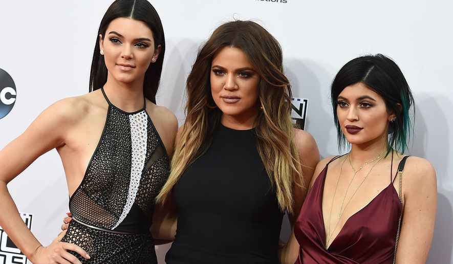 FILE - In this Sunday, Nov. 23, 2014, file photo, Kendall Jenner, from left, Khloe Kardashian and Kylie Jenner arrive at the 42nd annual American Music Awards at Nokia Theatre L.A. Live in Los Angeles. The Kardashian and Jenner families have such a heavy media, social and Internet presence, that some are wondering if there are signs of Kardashian Fatigue developing. (Photo by Jordan Strauss/Invision/AP, File)