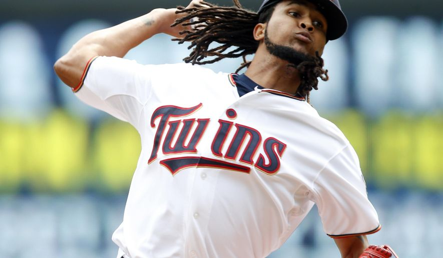 Minnesota Twins pitcher Ervin Santana throws against the Texas Rangers during the first inning of a baseball game, Thursday, Aug. 13, 2015, in Minneapolis. (AP Photo/Jim Mone)