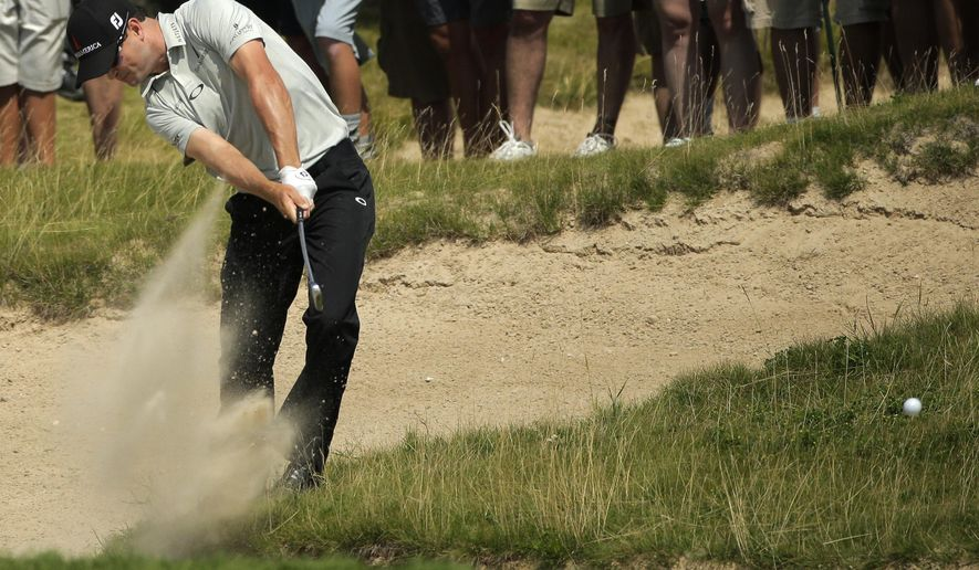 Zach Johnson hits out of a bunker on the second hole during the first round of the PGA Championship golf tournament Thursday, Aug. 13, 2015, at Whistling Straits in Haven, Wis. (AP Photo/Jae Hong)
