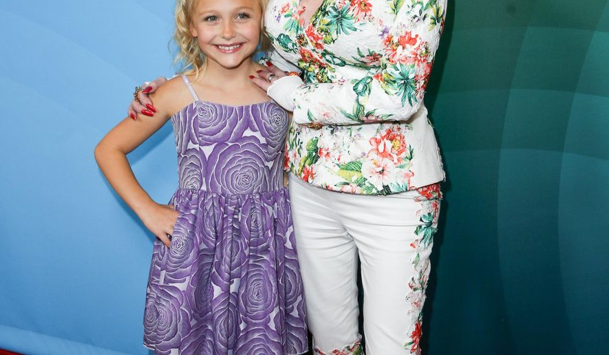 Alyvia Lind, left, and Dolly Parton arrive at the NBCUniversal Summer TCA Tour at the Beverly Hilton Hotel on Thursday, Aug. 13, 2015, in Beverly Hills, Calif. (Photo by Rich Fury/Invision/AP)