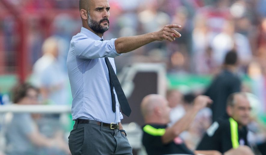 Munich's coach Pep Guardiola gestures during the German soccer cup first round match between fifth tier team FC Noettingen and Bayern Munich in Karlsruhe, southern Germany, Sunday, Aug. 9, 2015. (AP Photo/Daniel Maurer)
