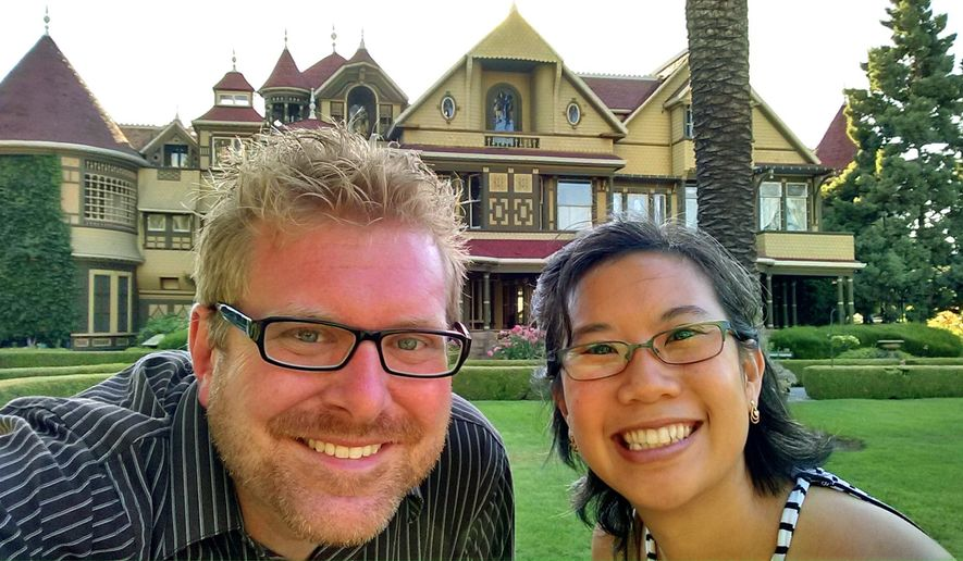 This July 3, 2015 photo supplied by Todd Kuhns shows Kuhns and his wife Bich Kuhns at Winchester Mystery House, a mansion and historic landmark open to tourists in San Jose, Calif. Kuhns was in San Jose on a business trip and used several mobile apps on the fly to organize a series of last-minute leisure outings. (Todd Kuhns via AP)