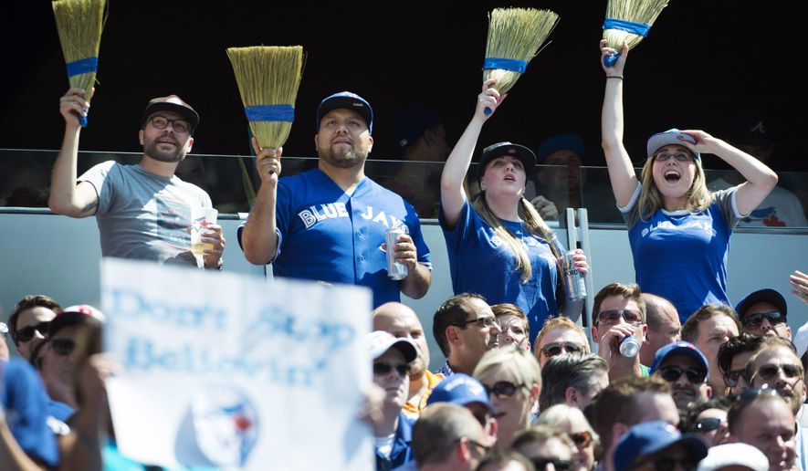 Fans celebrate the Toronto Blue Jays' series sweep of the Oakland Athletics during a baseball game in Toronto, Thursday, Aug. 13, 2015. (Darren Calabrese/The Canadian Press via AP) MANDATORY CREDIT