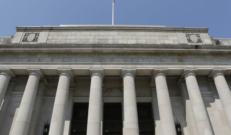 The Washington state Supreme Court is seen on Thursday, Aug. 13, 2015, in Olympia, Wash. The court has issued sanctions of $100,000 a day against the state for its lack of progress on a plan to full fund basic education. (AP Photo/Rachel La Corte)