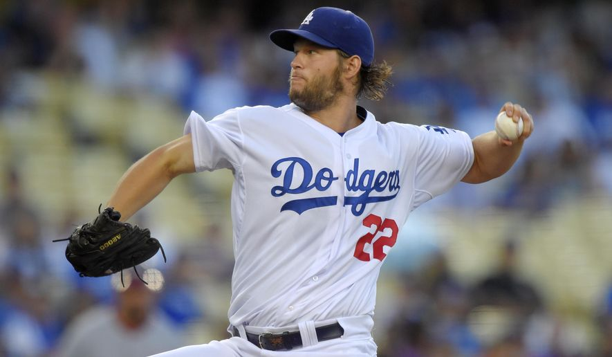 Los Angeles Dodgers starting pitcher Clayton Kershaw throws against the Washington Nationals during the first inning of a baseball game, Wednesday, Aug. 12, 2015, in Los Angeles. (AP Photo/Mark J. Terrill)